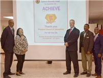 Board of Education Honored as Superheroes photo