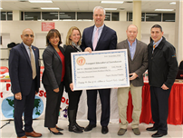Board Accepts $41,756 Check for District Projects photo